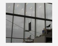 Chaise 2 (dessin à pattes)  2009 - dessin découpé et installé - encre de Chine sur Tyvek, 6 crochets - 1400x800cm  - Vue de l'exposition 13x13, Drissag Showroom Herentals (B) 2009      -       Chair  2009 (drawing with legs) - Installed cut out drawing - Indian ink on Tyvek, 6 hooks,     © Benoît Félix 2009